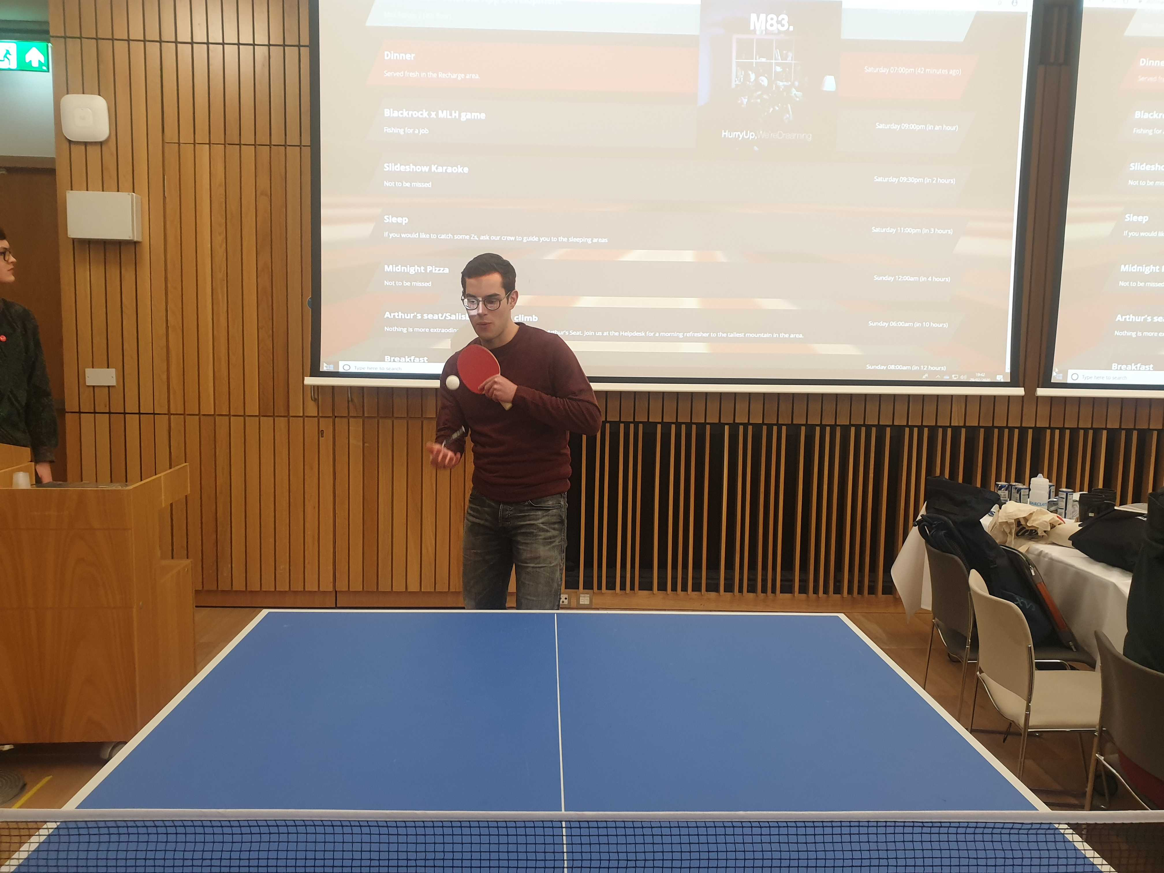 Marius and Charlie playing table tennis